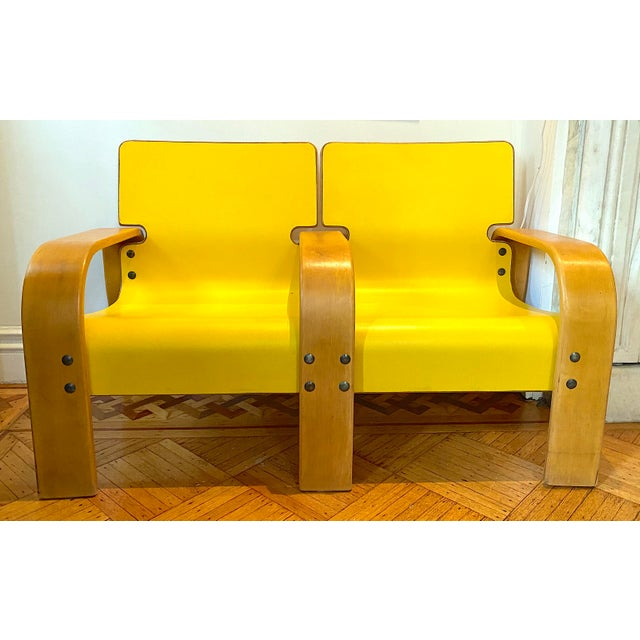 Unique Italian Modern double seating. well made with custom hardware and the original yellow color which screams 60s/70s....
