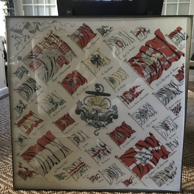 This chic and graphic vintage framed Hermes scarf makes quite the statement in red, ivory and grey. The scarf is a rare...