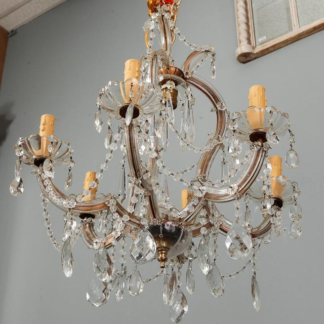Circa 1930s Maria Theresa chandelier with brass frame, six glass covered arms, candle style lights with scallop edge glass...