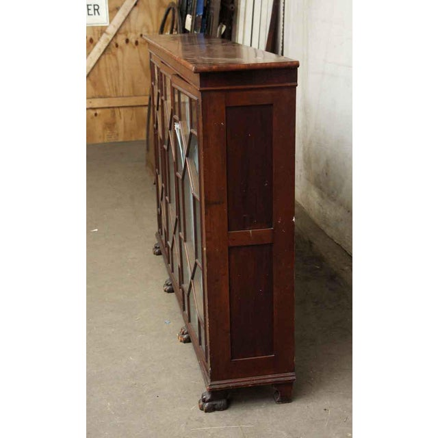 Wood 20th Century Traditional Mahogany Claw Foot Breakfront Bookcase With Glass Doors For Sale - Image 7 of 11