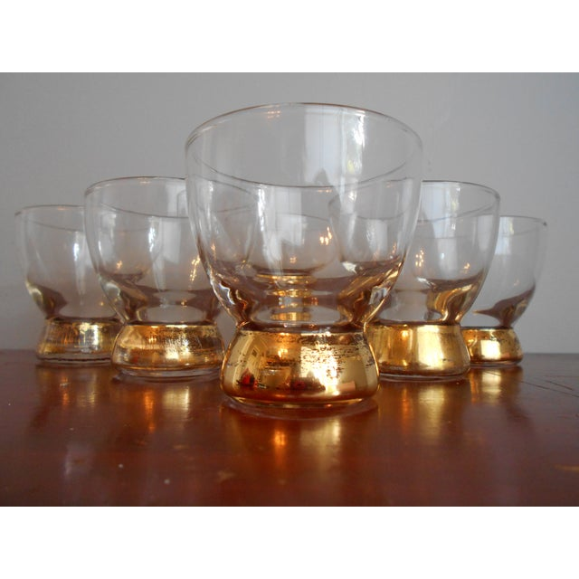 Set of 6 Mid-Century highball glasses with gold bases. The set is in excellent condition with no chips or cracks. Some age...