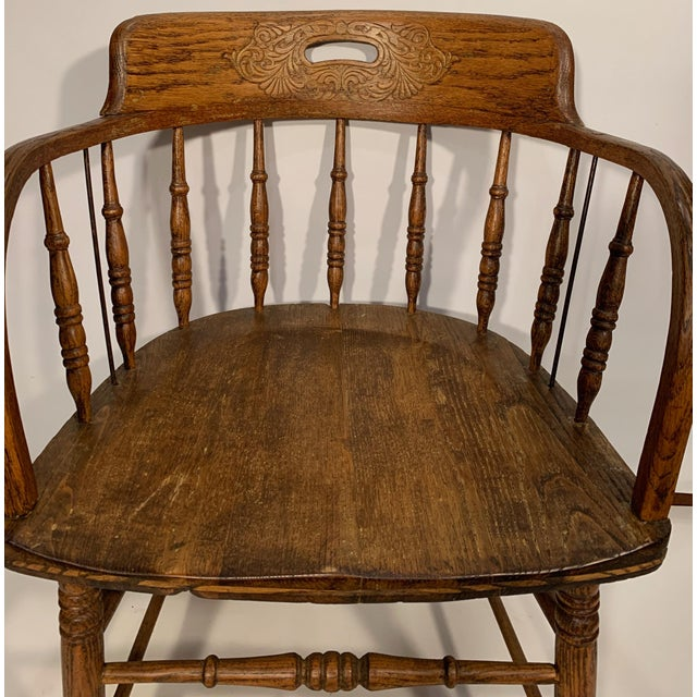 Pressed carved bow back captain's chair - hand hold in the back - good spindles and solid construction