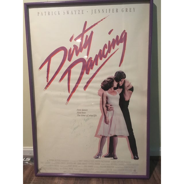 Original dirty dancing movie poster. Personalized and signed by Patrick Swayze. Professionally framed. Signature faded but...