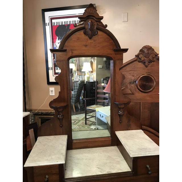 Beautifully Carved Victorian Marble Top Drop Center Vanity with Carved Crown and Original Teardrop Pulls. Condition is...