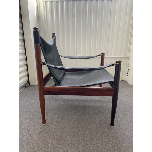 Handsomely crafted mid-century modern safari lounge chair designed by Erik Worts for Niels Eilersen, Denmark. Rosewood and...