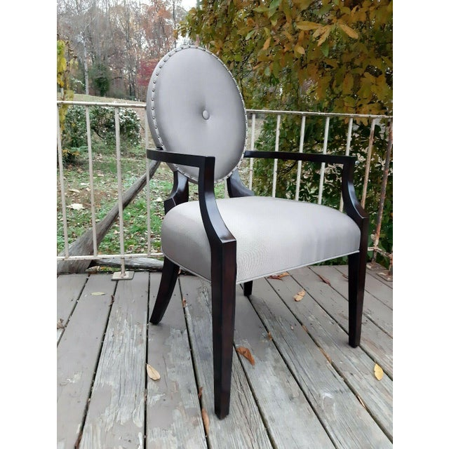 Item offered is a set of nice contemporary Bernhardt Jet Set Gray Upholstered Arm Chairs in Caviar finish wood arms and...