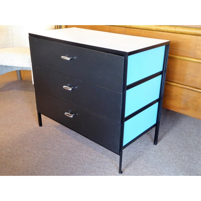 Quite nice steel frame dresser by George Nelson for Herman Miller consisting of a white mica top and three drawers with...