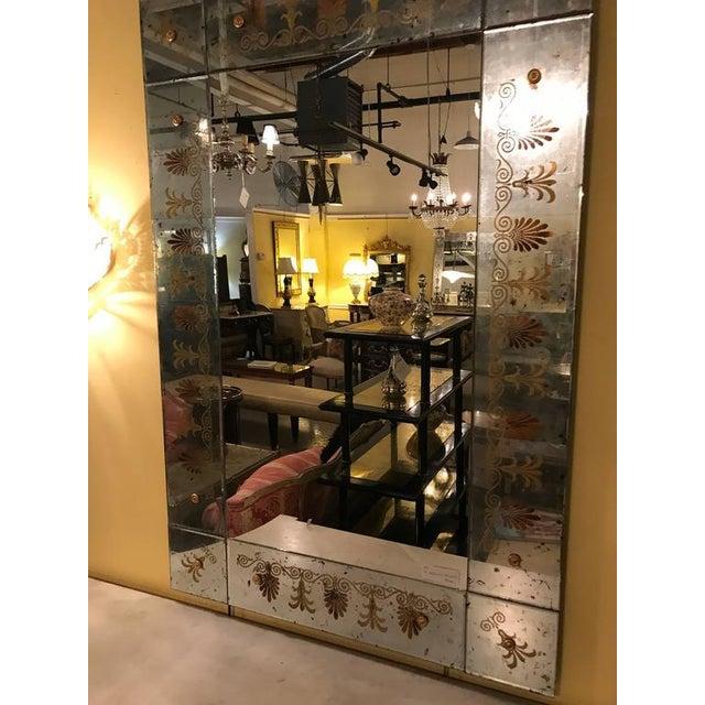 A pair of Maison Jansen églomiséd framed mirrors. Pair of gorgeous Venetian style Verne églomisé glass mirrors, the framed...