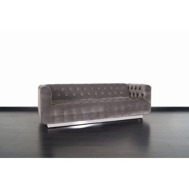 Spectacular vintage chrome sofa by California designer George Kasparian for Kasparian Inc. Professionally reupholstered in...