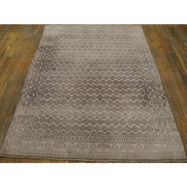 Antique Indian Agra Rug with an ivory background.