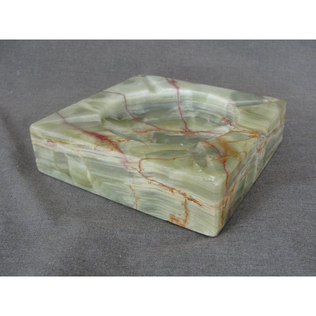 """This is a beautiful mid century modern Onyx ashtray in green with brown streaks. The ashtray measures 5 3/8"""" across and 1..."""