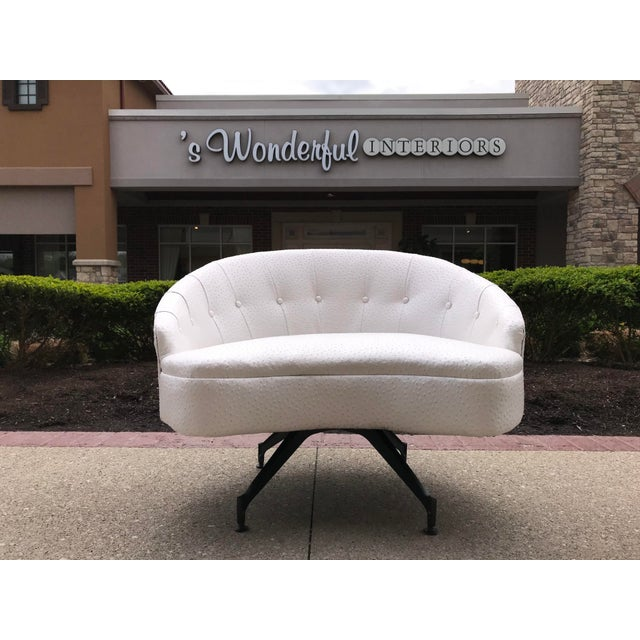 Restored Mid-Century-Modern lounge chair and ottoman recovered in a pearl finish vinyl with an Ostrich texture. New black...