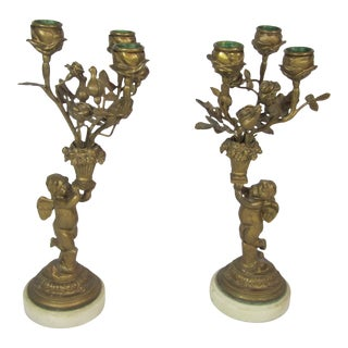 Bronze Cherub Candelabras - A Pair For Sale