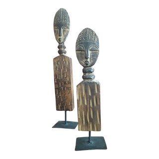 Hand Carved African Wood Statues on Metal Pedestals - A Pair For Sale