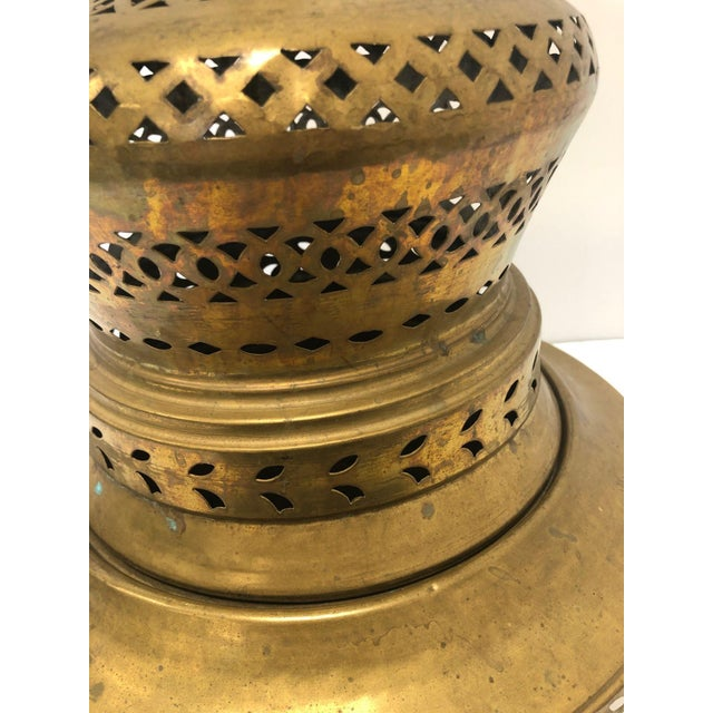 Antique metal incense holder, reminiscent of Turkish or Morroccan style, lots of tiny cut out details make up a geometric...