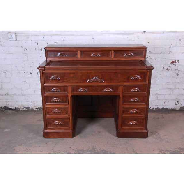 Offering an exceptional and truly one-of-a-kind 19th Century Victorian carved mahogany railroad desk. The desk came from a...