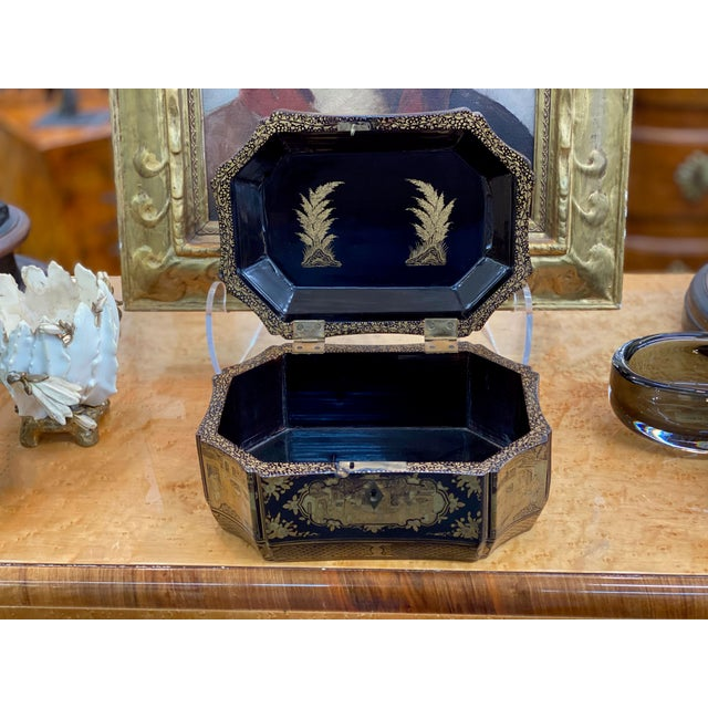 Chinoiserie black lacquer and gilt wooden box, hinged top. Top does have a split to the veneer. Priced as is. Late 19th...