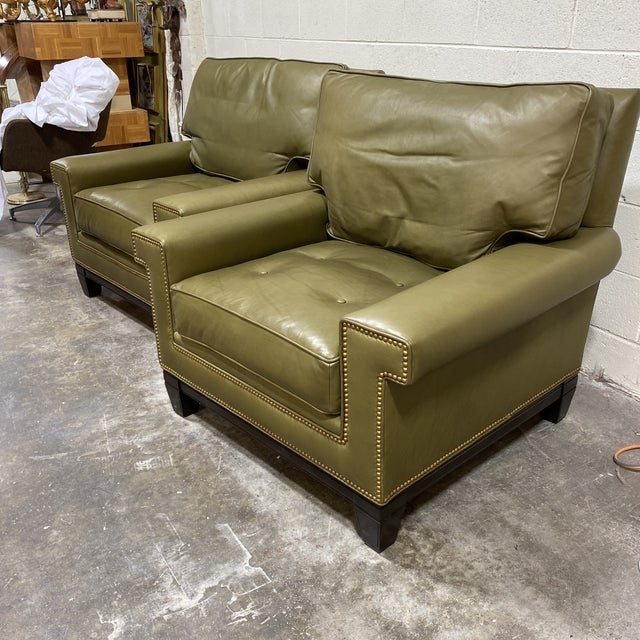 Olive green leather and walnut finish legs on this scrumptious pair of Swaim club chairs. If you know you know. Swaim has...