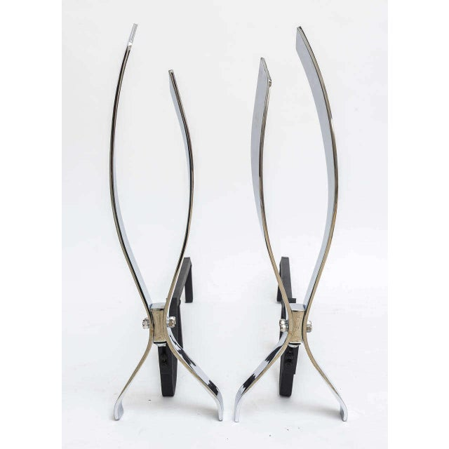 This handsome set of fireplace andirons are very much inspired by pieces created by Danny Alessandro of New York City....