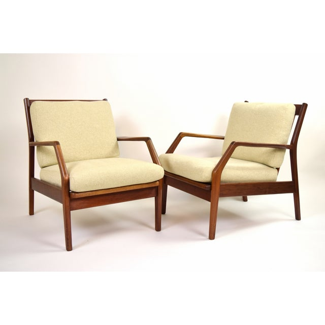 Beautiful pair of vintage custom made lounge armchairs in the style of Ib Kofod Larsen's signature design. Well built,...