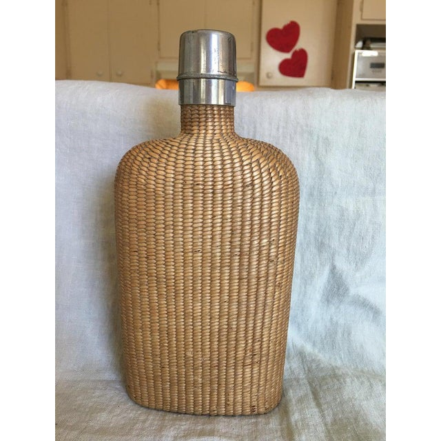 English summer rattan covered flask with a brass top, 19th century.