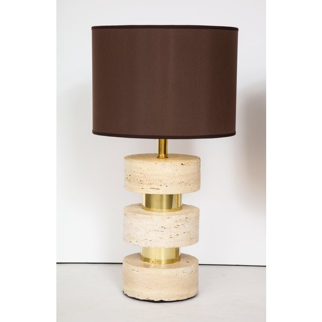 Pair of Italian 1970s travertine and brass table lamps, the three circular travertine blocks interspersed by brass...