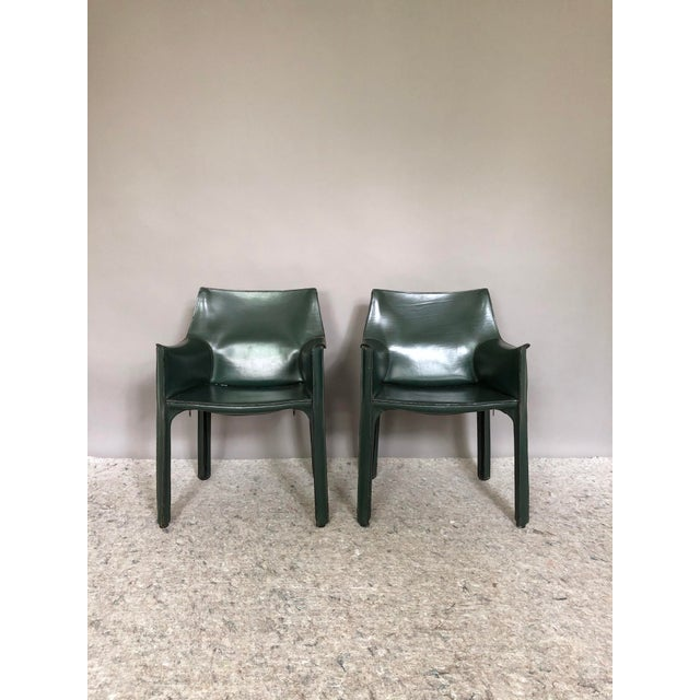 Offering a pair of beautiful Cassina CAB 413 dining/side chairs in a dark green stitched saddle leather. Designed by Mario...