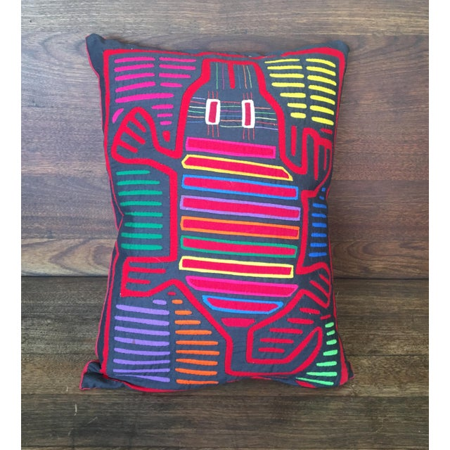 This custom pillow is made with an Original Mola Cloth from Guatamala. Hand stitched in traditional fashion, this cloth is...