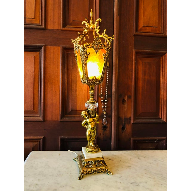 "Vintage Italian Cherub Lamp Missing one amber glass panel, replaced with clear. Measurements 32""H x 7""W x 7""D"