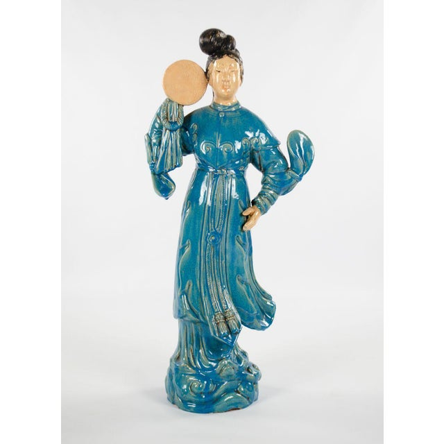 Bring something new and interesting to your decor with this impressive pair of Chinese male and female ceramic dancing...