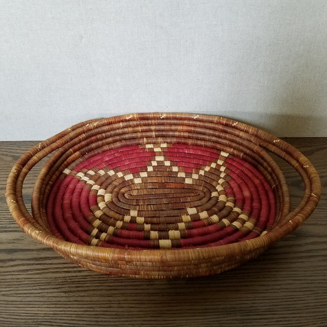 Vintage hand woven African coiled basket tray. The basket is tightly woven and the pattern is stunning. Utilize as a wall...