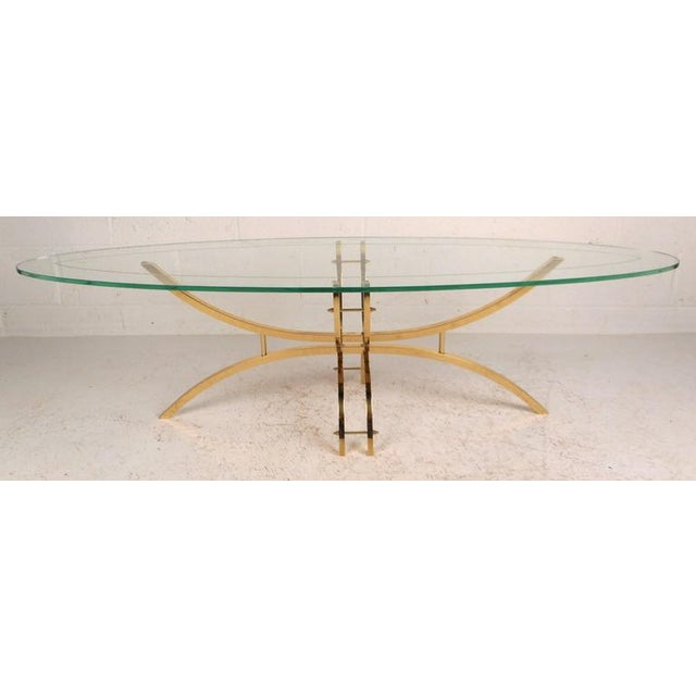 This beautiful contemporary modern coffee table features a unique surfboard shaped glass top. The thick green glass sits...