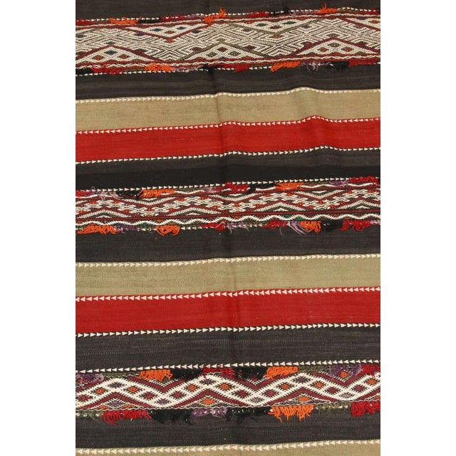 Vintage Moroccan flat-woven Tribal Kilim rug from the Middle Atlas of Morocco, North Africa. Handwoven in stripes of red...