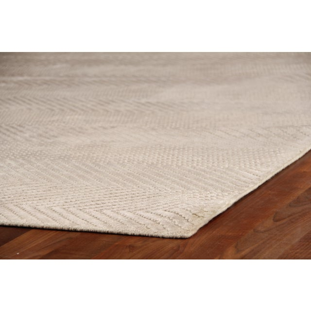Luxurious Art Silk and a soft color palette come together in subtle, but stunning herringbone pattern to create our...