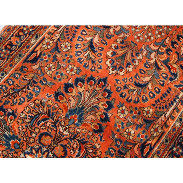 Antique Persian Sarouk rug in original good condition. The rug is from the beginning of 20th century, made in red wool.