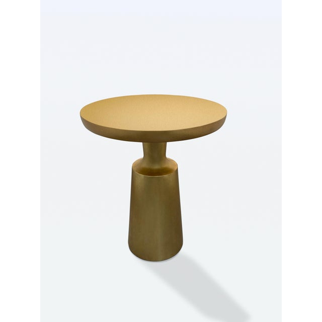 """Pair of beautiful Holly Hunt gold """"Peso"""" side tables. These side tables are in excellent condition and would be a stunning..."""