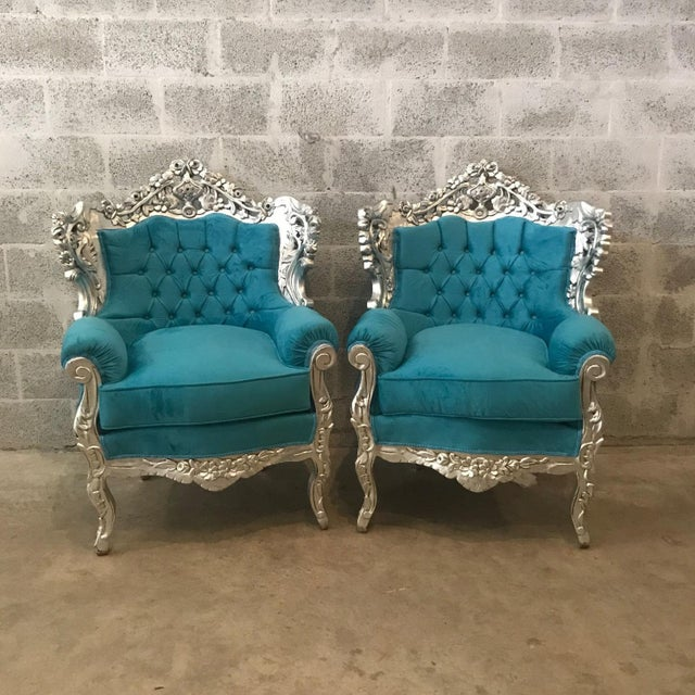 Italian Baroque style chairs refinished in Italy and reupholster tufted using a blue teal suede fabric. These unique...