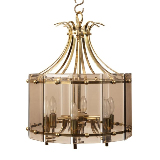 A beautiful pair of mid-century chandeliers hung with an s-hook in elegant brass