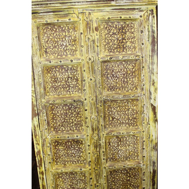 Wood Vintage Yellow Antique Carved Detail Indian Armoire For Sale - Image 7 of 8
