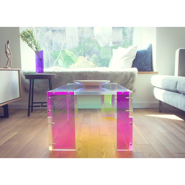 """Laurent coffee table by Diogo and Juliette Felippelli Laurent coffee table Dichroic film on acrylic Measures: 38"""" L x 20""""..."""