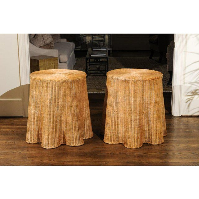 An exquisite pair of difficult to find vintage Trompe L'oiel Wicker end tables. Fabulous design, craftsmanship and...