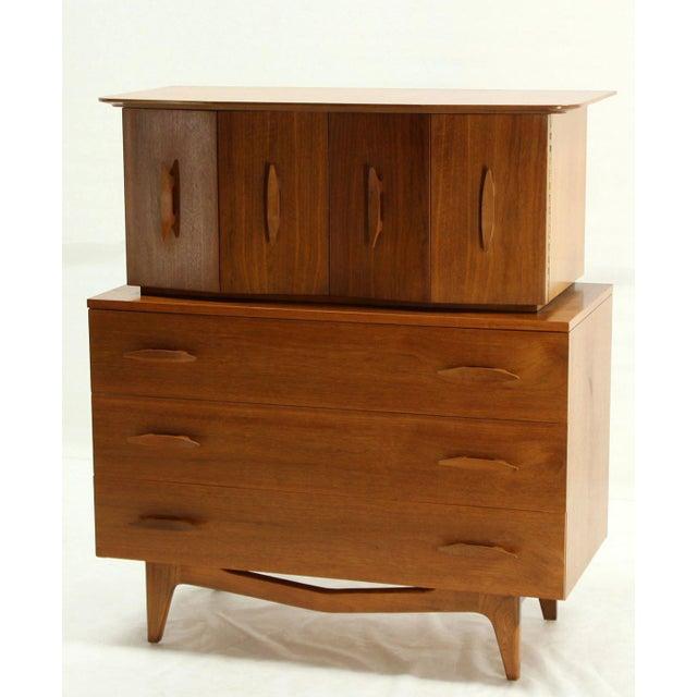 Banana shape pulls mid-century Danish modern walnut gentlemen chest of drawers.