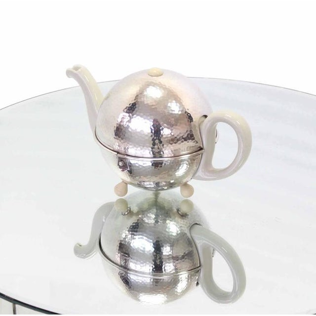Very cool tea pot in hammered silver plate insulated cover.