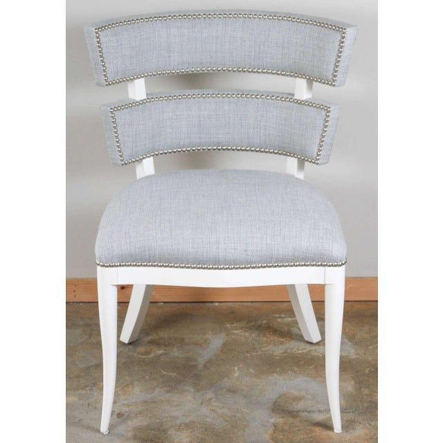 Paul Marra Klismos Style Chair shown in white lacquer, antiqued nail head, and com. Shown as example, by order COM 2.5 yards.