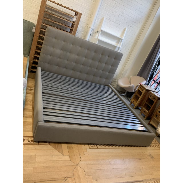 Design Plus Gallery presents an Avery Eastern King Storage Bed Frame. Soft fabric upholstery embellished with tufting puts...