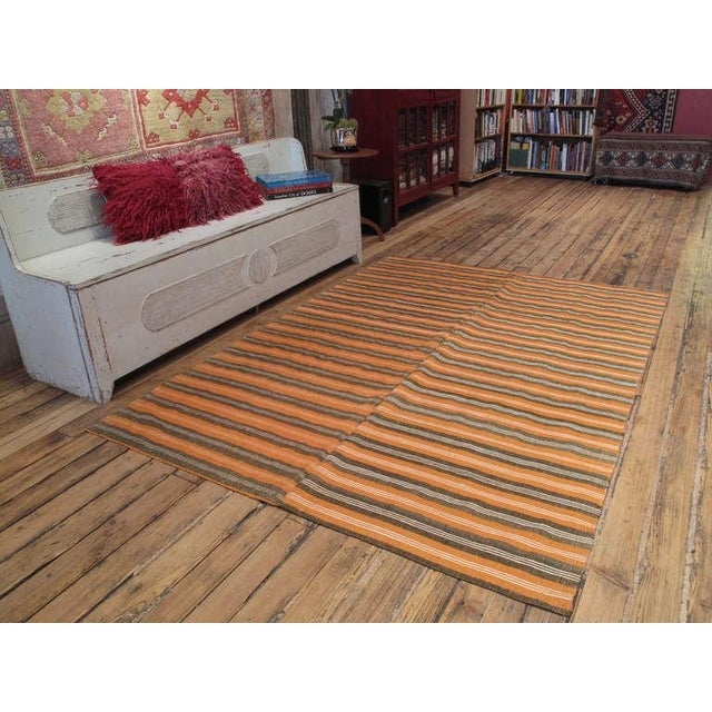 A simple old cover from Southern Turkey woven in two panels on a narrow home loom. It is sturdy enough to be a floor cover...