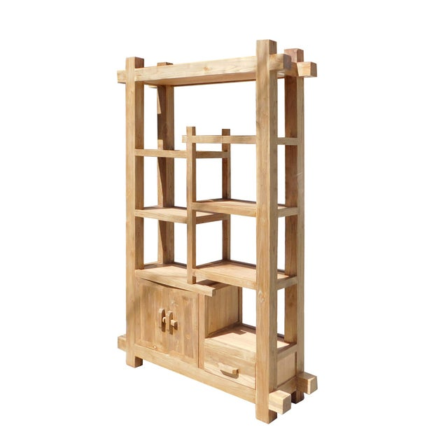This is a display cabinet made of natural raw wood. It has an uneven shelves for display or for books. A drawer and a...