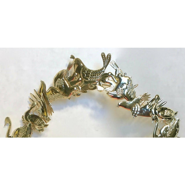 """This Dresden brass holiday wreath is in excellent condition, still bright and shiny. Maker's mark on bow is """"Mann 1982""""...."""