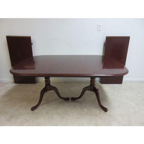 https://chairish-prod.freetls.fastly.net/image/product/sized/98305491-8310-4edf-b655-48cdb47e8f40/pennsylvania-house-cherry-2-board-pedestal-conference-banquet-dining-room-table-9195?aspect=fit&width=640&height=640