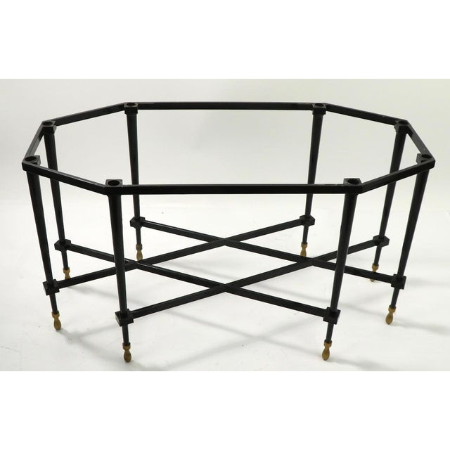 Tray top coffee, cocktail table having a removable tray top surface which rests on an architectural octagonal base. The...